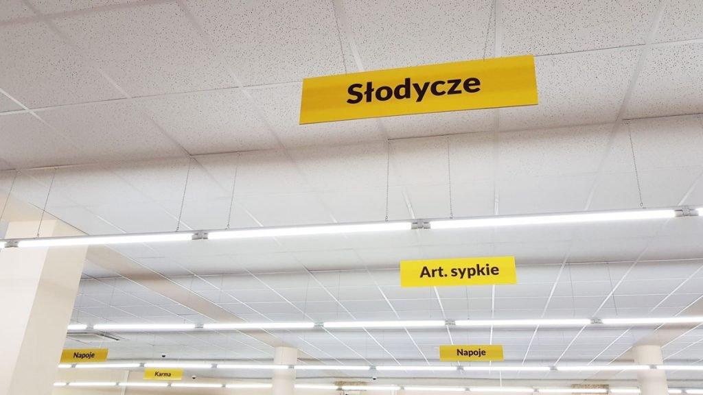 tabliczki podwieszane do sklepu