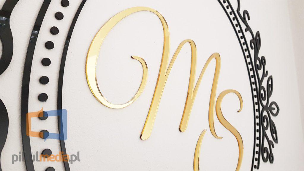 logo 3d z złotym kolorze