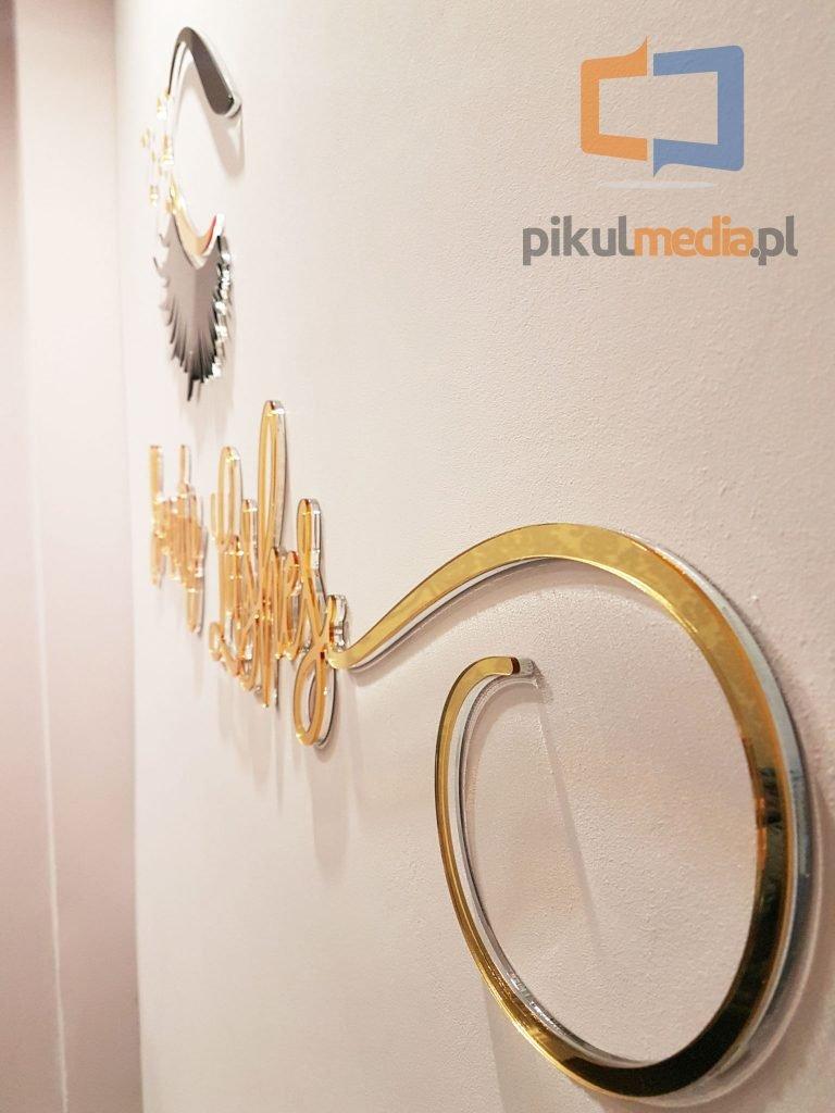 logo ze złotego lustra