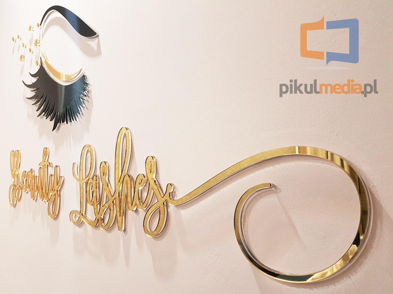 logo 3d ze złotych liter