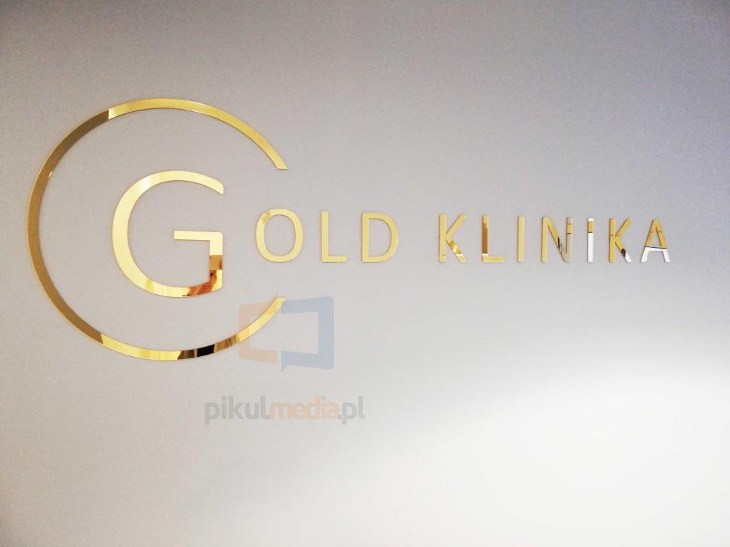 złote logo na ścianę