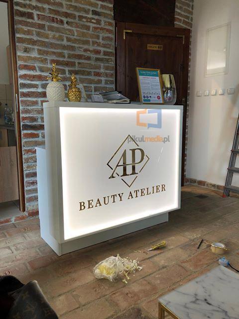 Podświetlone logo 3d ze złotego lustra